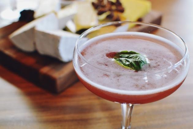 Grand Marnier, Chambord, fresh pressed strawberry, fresh basil, spice syrup, twist of black pepper served in a martini glass