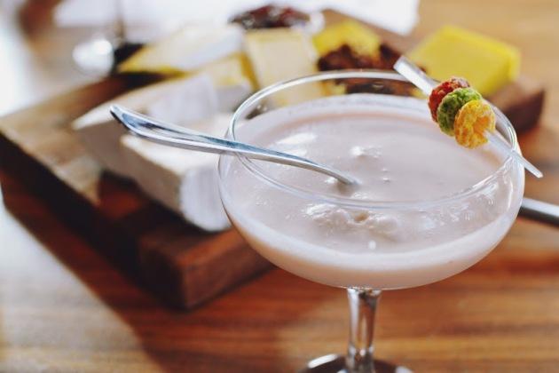 Fruit Loop infused vodka, Cointreau, coconut syrup, pineapple juice, fresh pressed strawberry